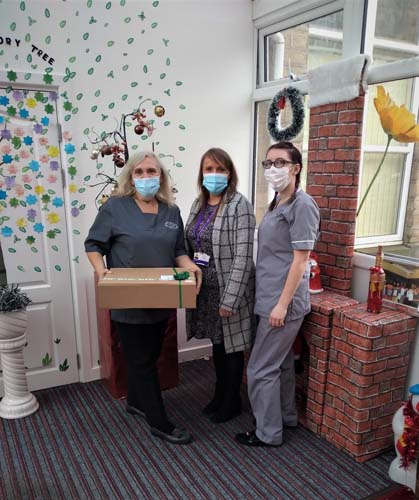 Croftlands Care home in Huddersfield receiving their Christmas Hamper from Number 1 Healthcare